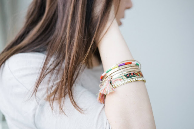 Close up of a woman's arm and the bangles she's wearing.