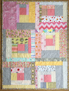 log cabin baby quilt in grey yellow and pink fabrics