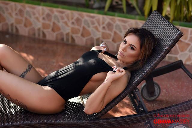 Gemma Massey stretching black bodysuit straps