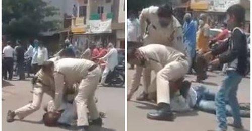 """कोरोना वायरस से बचाव के लिए कथित तौर पर मास्क नहीं लगाने को लेकर विवाद के बाद यहां परदेशीपुरा क्षेत्र में 35 वर्षीय व्यक्ति को दो पुलिस आरक्षक ने मंगलवार को सड़क पर गिराकर बुरी तरह पीटा. घटना का वीडियो वायरल होने पर दोनों पुलिस कर्मियों को निलंबित कर दिया गया है.   वीडियो में दो पुलिस कर्मी एक व्यक्ति को बुरी तरह पीटते दिखाई दे रहे हैं, जबकि उसका किशोर बेटा और कुछ महिलाएं पुलिसकर्मियों से रहम की भीख मांगती नजर आ रही हैं. पुलिस अधीक्षक (पूर्वी क्षेत्र) आशुतोष बागरी ने बताया कि वीडियो में दिखाई दे रहे दोनों आरक्षकों को अनुचित बर्ताव के चलते निलंबित कर दिया गया है और एक शहर पुलिस अधीक्षक (सीएसपी) को मामले की जांच का जिम्मा सौंपा गया है.   काट-छांट कर तैयार किया गया है वीडियो- बागरी   बागरी ने दावा किया कि वीडियो में दिखाई दे रहे व्यक्ति ने मास्क नहीं पहन रखा था और दोनों पुलिसकर्मियों ने उसे रोका, तो उसने पुलिसकर्मियों से हुज्जत करते हुए उनका कॉलर पकड़ा व उनके साथ गाली-गलौच की और मारपीट की कोशिश की.       उन्होंने कहा, """"घटना का जो वीडियो सोशल मीडिया पर वायरल हो रहा है, वह काट-छांट कर तैयार किया गया है ताकि पुलिस की छवि खराब की जा सके."""" पुलिस के एक अन्य अधिकारी ने बताया कि जिस व्यक्ति ने पुलिसकर्मियों से कथित विवाद किया, उसकी पहचान कृष्णकांत कुंजीर (35) के रूप में हुई है. पुलिस अधिकारी के मुताबिक कुंजीर स्मैक का आदी है और उसके खिलाफ चाकूबाजी तथा जबरिया उगाही के मामले भी दर्ज हैं.   विपक्षी कांग्रेस ने साधा बीजेपी पर निशाना   इस बीच, वायरल वीडियो के हवाले से सोशल मीडिया पर लोग पुलिस के रवैये की तीखी आलोचना कर रहे हैं. विपक्षी कांग्रेस के कई नेताओं ने भी इस मामले में राज्य की बीजेपी सरकार पर निशाना साधा है."""