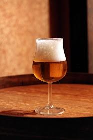 Glass of Wyeast De Bom fermented saison.