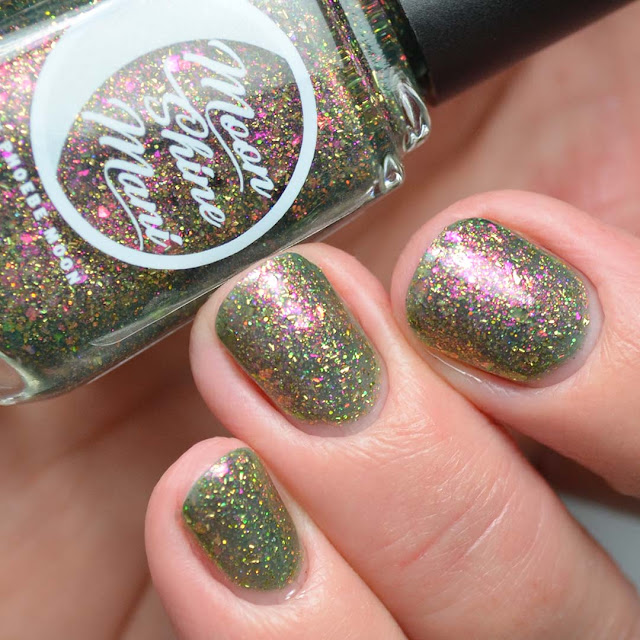 green nail polish with color shifting flakies swatch