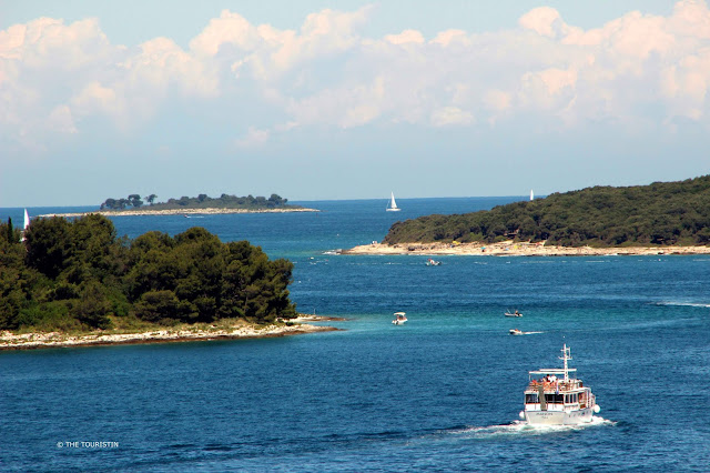 Rovinj, Croatia, Europe, Mediterranean Sea, ferry boat, blue water, sky, sailing boats.
