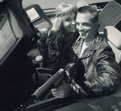 Corinna Everson with her co-actor sitting inside the car