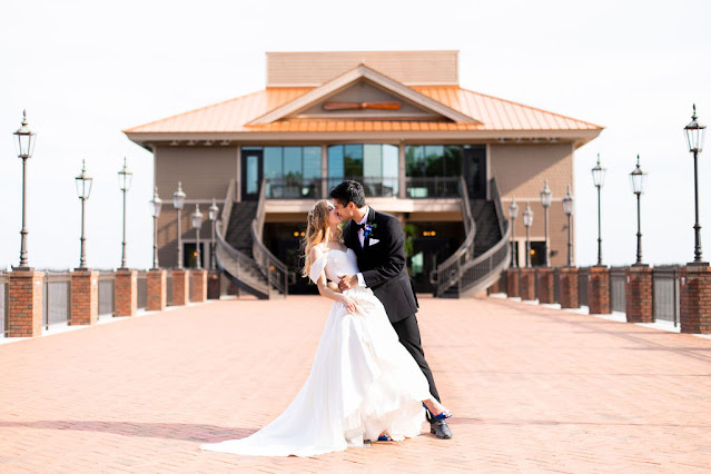 bride and groom in front of tavares pavilion on the lake