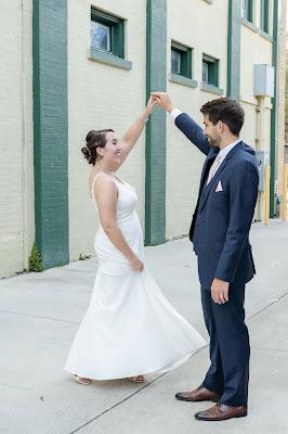 groom twirling bride around