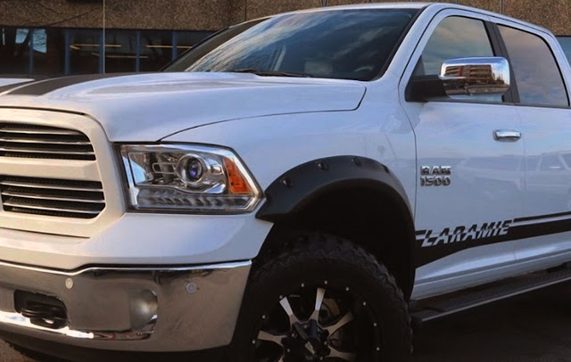 black-laramie-stripe-and-ram-1500-emblem-on-white-dodge-truck
