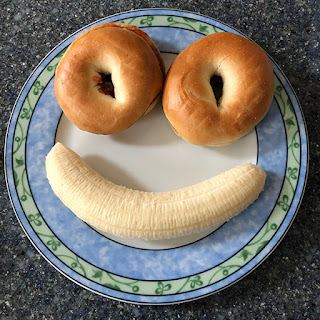 Low Fat breakfast, bagel, jam, and banana