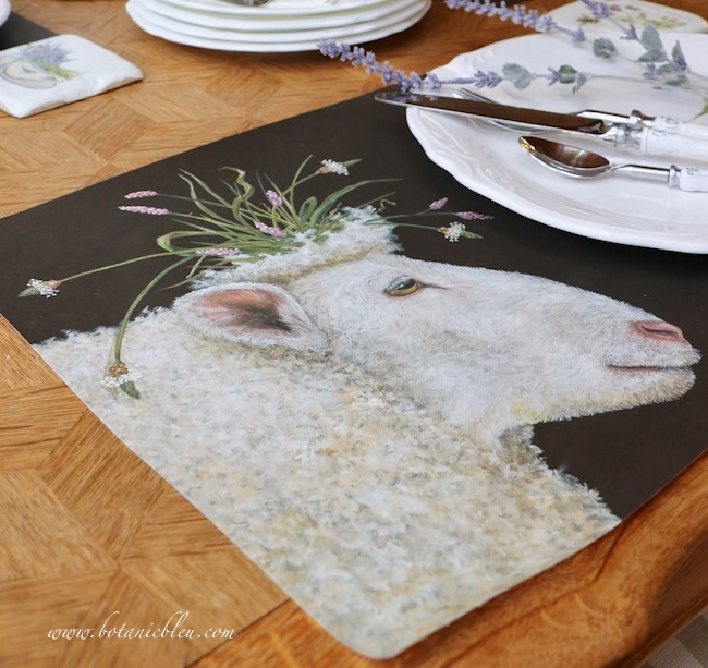 Whimsical Summer Lavender Tablesetting has sheep with wildflower crown paper placemats
