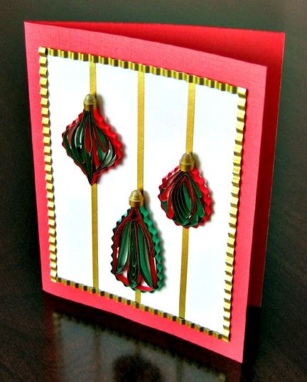 handmade card with three red and green paper quilled ornaments
