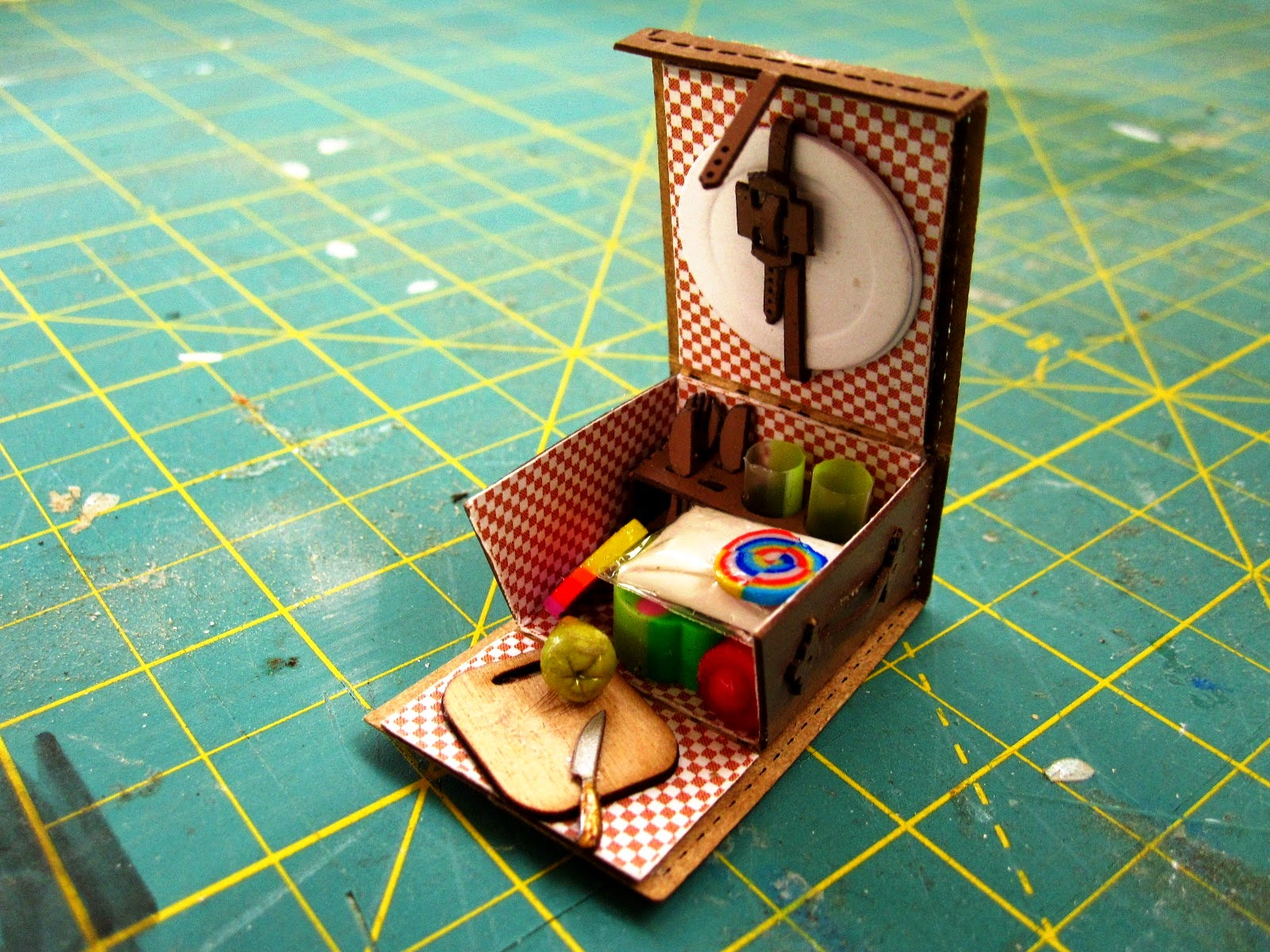 Miniature picnic basket with contents.