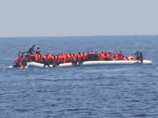 Bolstered Libyan coast guard intercepts packed migrant boat.
