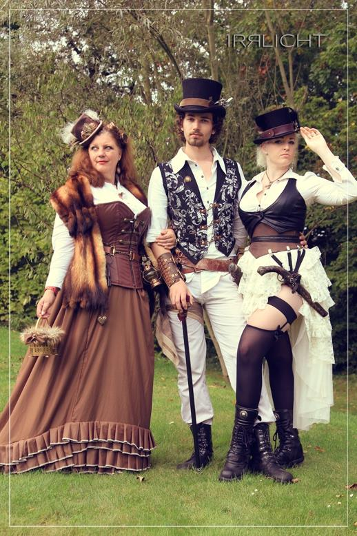 Man and 2 women wearing steampunk clothing and accessories. steampunk fashion inspiration for men and women.