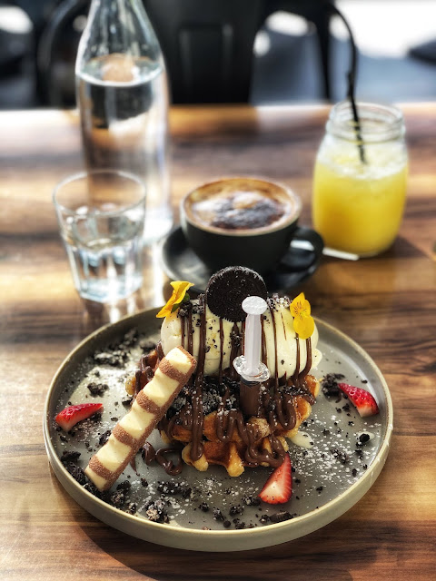 adonis cafe in brisbane breakfast waffles with kinder bueno