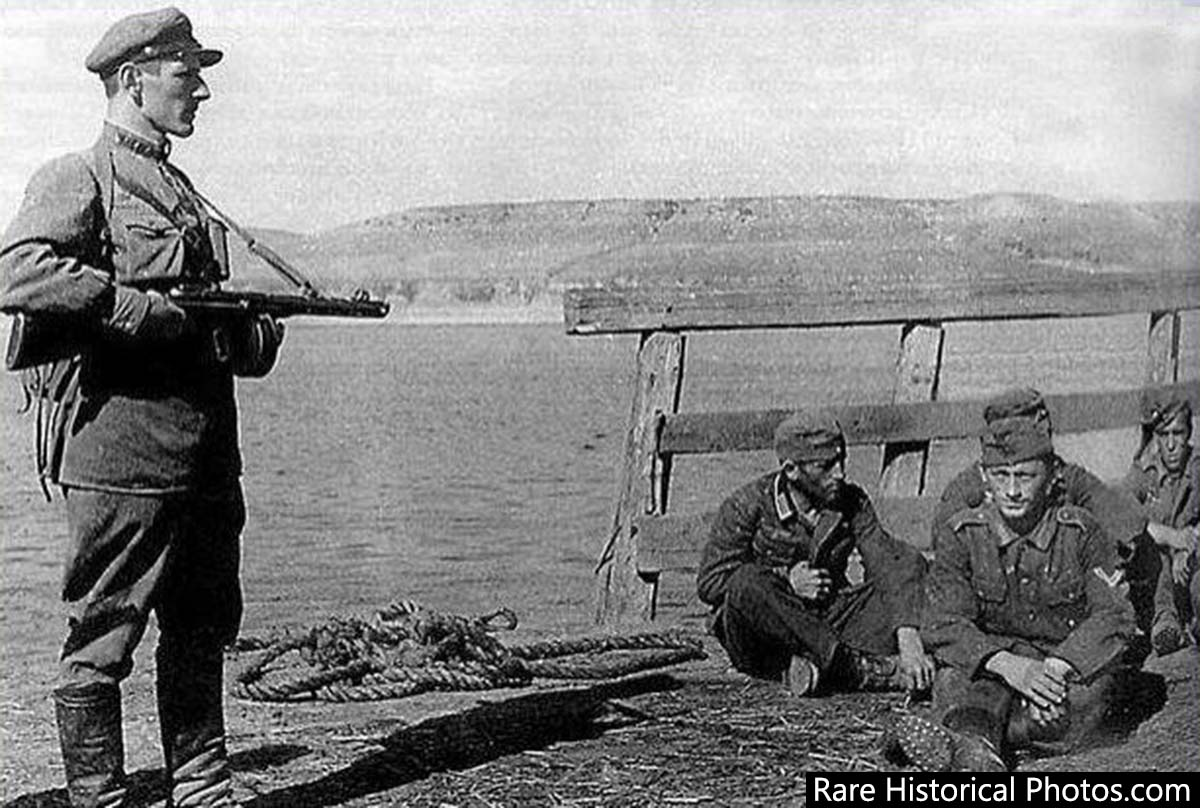Captured German soldiers under a Red Army guard on the Volga. 1942