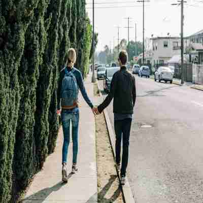 two close friends walking on road together