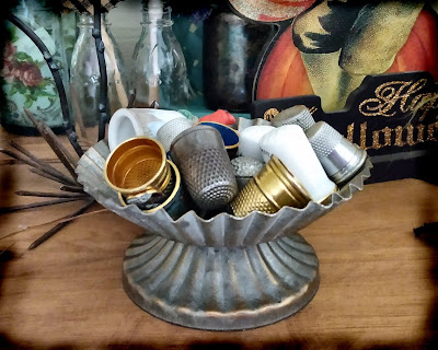 tinware with thimbles inside