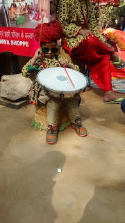 Local Rajasthani boy playing drum at Surajkund Crafts Fair