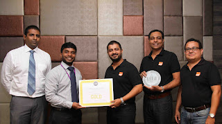 Saif Yusoof, Managing Director, EFL Sri Lanka (R) receives the LEED Gold certificate from Aazim Nafaiz, Director Carbon Solutionz. Also in the picture are (L-R) Nanda Abeysekera (Associate – Carbon Solutionz), Jagath Pathirana (CEO/Director - EFL Sri Lanka) and Shiran Dias (General Manager - HR & Administration - EFL Sri Lanka)