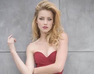 Amber Heard to give away her 7million divorce settlement to charity. Details at JasonSantoro.com