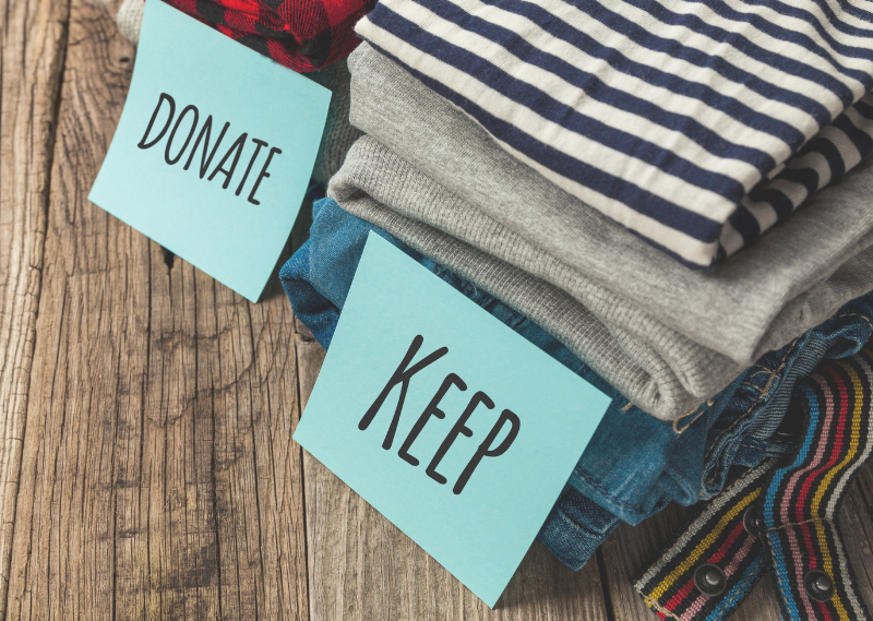 A donate and a keep pile in a post about how to effectively declutter and organise your home.