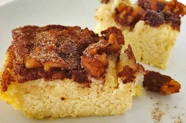 this is a coffee cake with a streusel topping and nuts on top