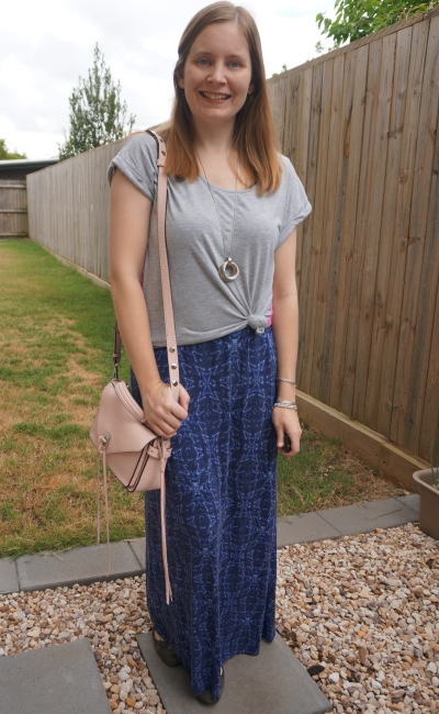 spring layered maxi dress outfit grey tee knotted over navy dress pastel pink bag | awayfromblue