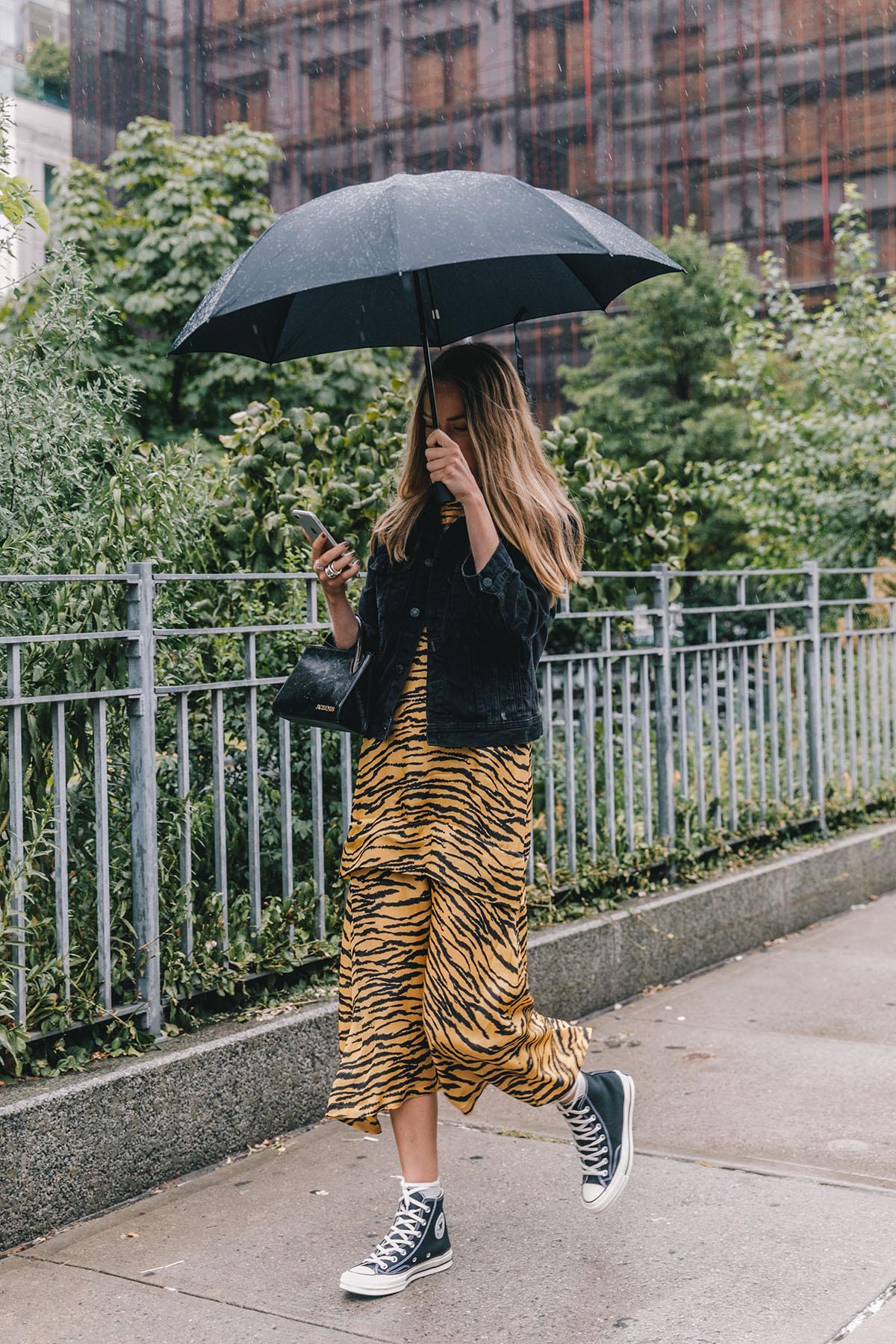 Stylish Rainy Outfit Idea — Animal Print Dress, Denim Jacket, and Converse Sneakers