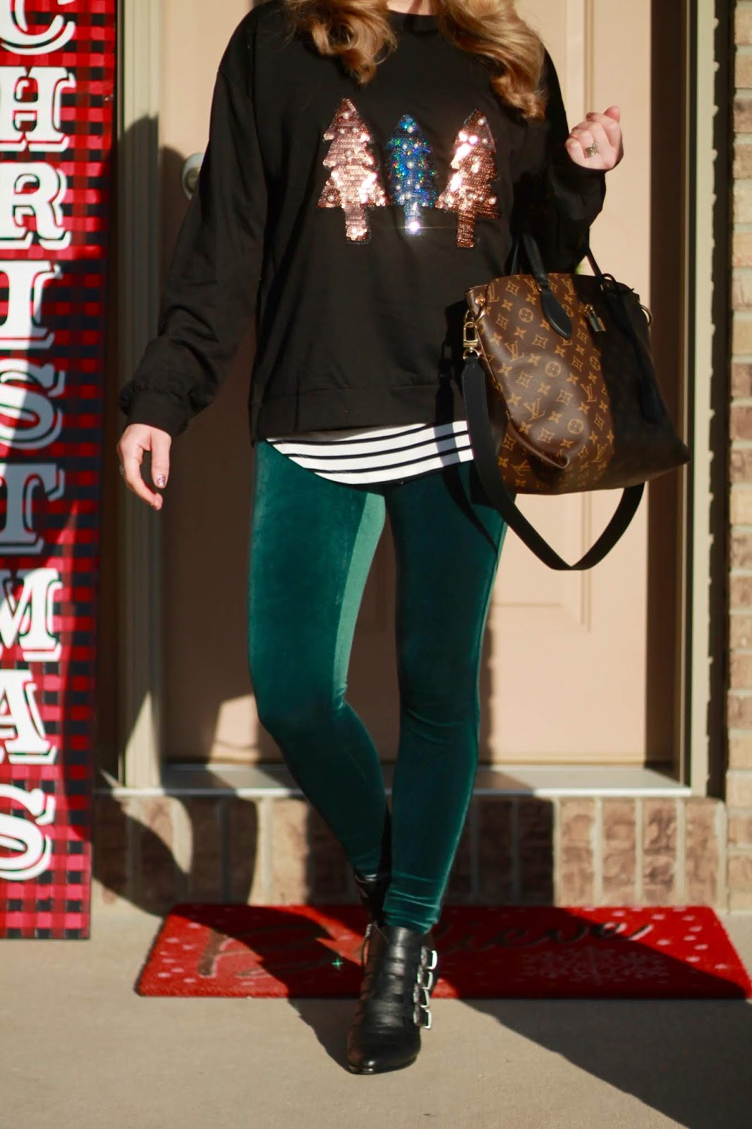 spanx velvet leggings, LV flowered tote, black sequin christmas tree sweatshirt, striped tee, black buckled ankle booties