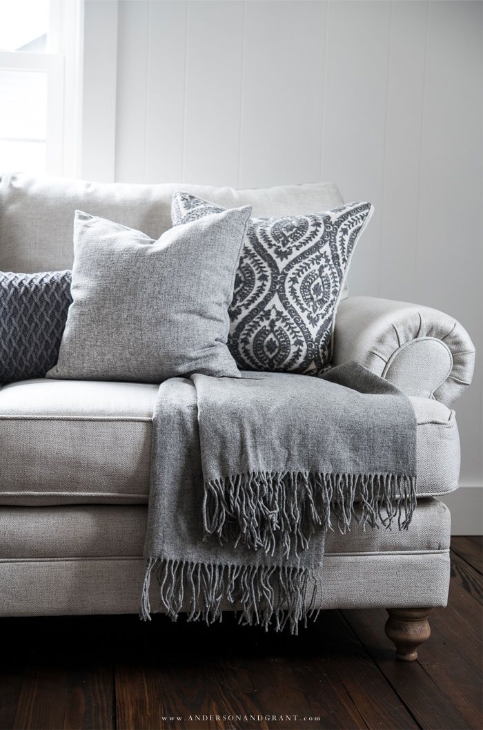 Neutral linen sofa with gray throw and pillows