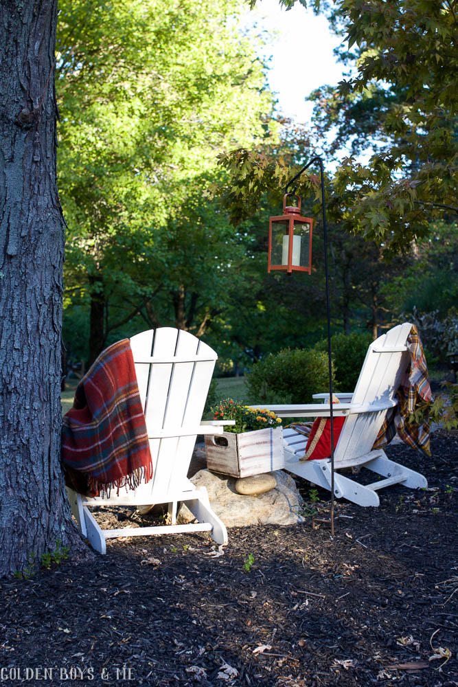 Adirondack chairs with plaid blankets and outdoor fall decor ideas