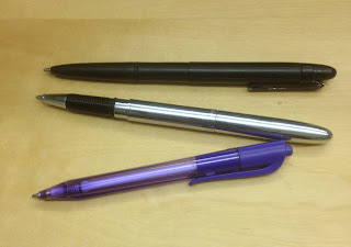 3 pens on table