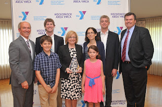 """""""CA Robbins Family, Ed Hurley, Brian Earley"""":  The Robbins Family received the YMCA's prestigious Chairman's Award.  Pictured in the back row are (from left to right) Hockomock Area YMCA President Ed Hurley, Robbie Robbins, Terry Robbins, Donna Robbins, Jason Robbins and Hockomock Area YMCA Board of Directors Chairman Brian Earley.  James Robbins (left) and Mary Jane Robbins are in the front row"""