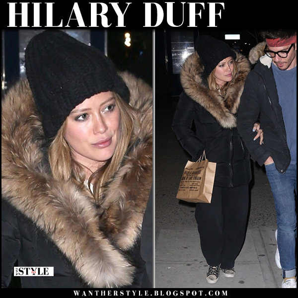 Hilary Duff in black fur trim down coat mackage and sneakers golden goose winter style april 10