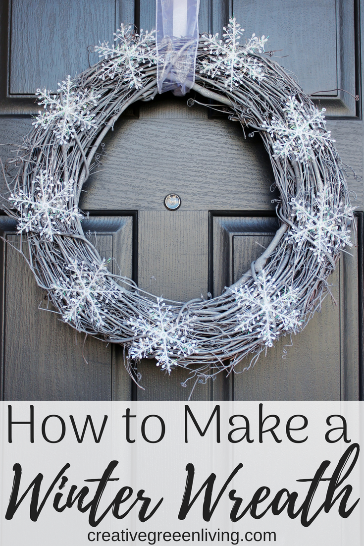 I love this pretty snow wreath for non-christmas decor! This DIY snowy wreath is perfect for your front door in January through Valentine's Day. The rustic look is perfect for after Christmas and goes well with farmhouse style. The silver and white combined with dollar store snowflakes and a hint of glitter make it the perfect non-Christmas winter wreath! #creativegreenliving #winterwreath #snow #winterdecor #DIYwreath #wreathideas