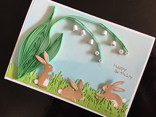 Hand made birthday card with quilled lily of the valley and die cut rabbits