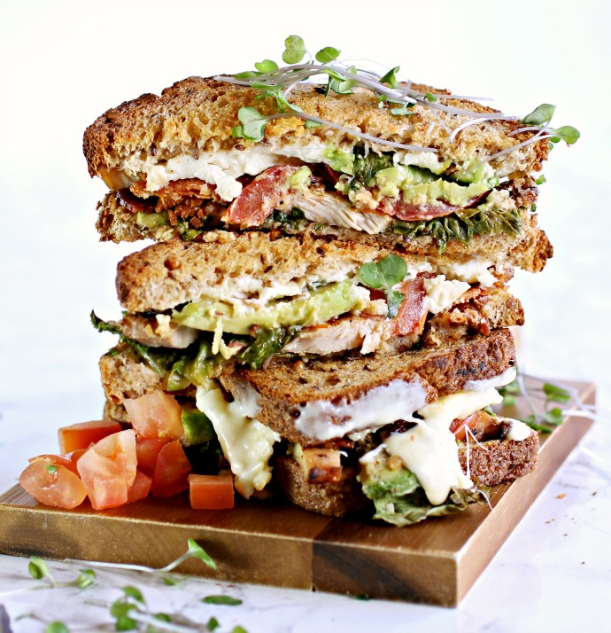 Recipe for a grilled cheese sandwich with chicken avocado, tomato, bacon and blue cheese.