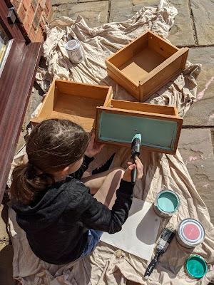 Daughter painting furniture