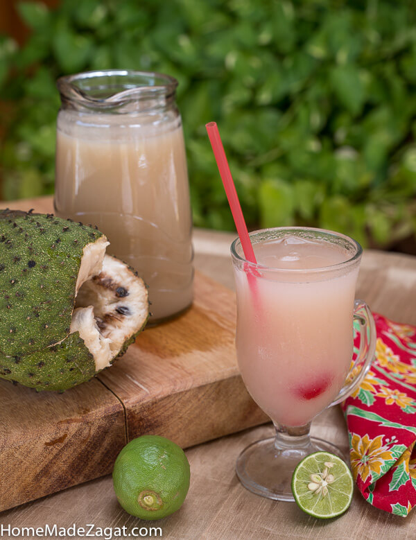 Jug and glass of soursop drink with soursop