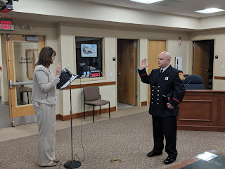 Peter Ballou was sworn in by Town Clerk Teresa Burr