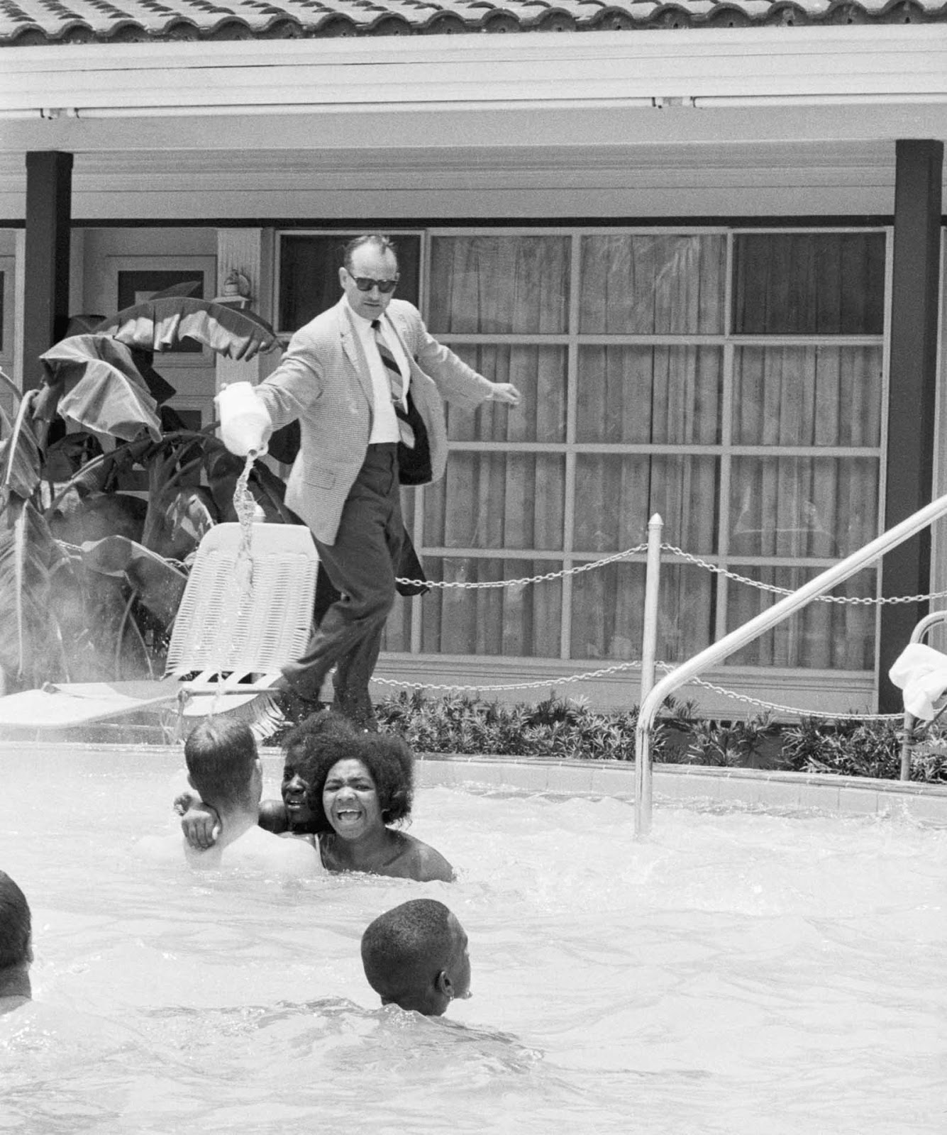 James Brock, the manager of the motel, was photographed pouring muriatic acid into the pool to get the protesters out.