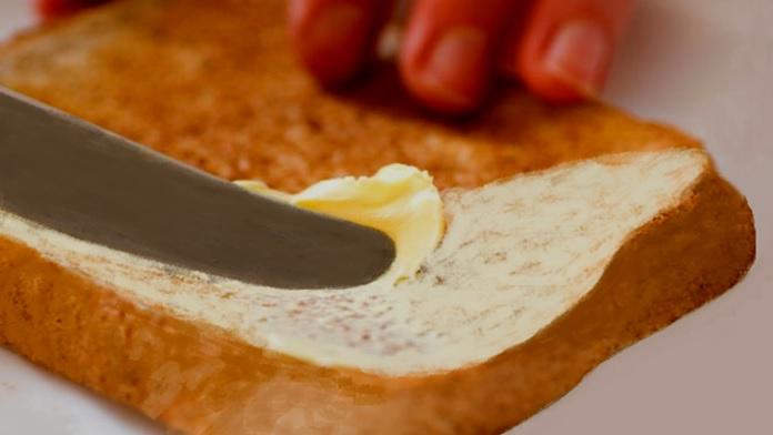 Una fetta di pane caldo imburrato