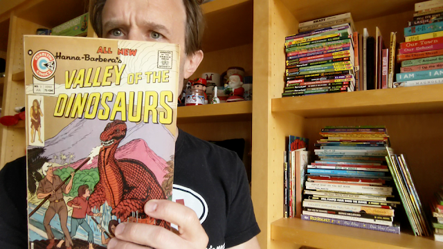 picture of a guy holding vintage comic book