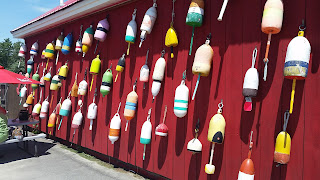 Bouy fishermen memorial wall at Carrier's Mainely Lobster in Buckport, Maine