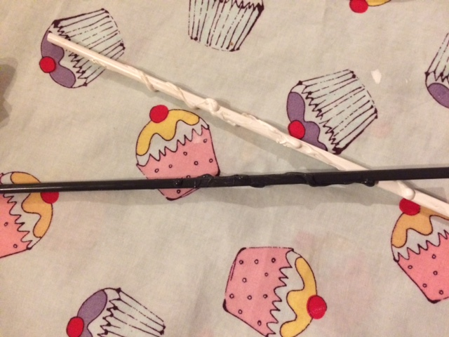 The chopsticks now painted and looking like wands