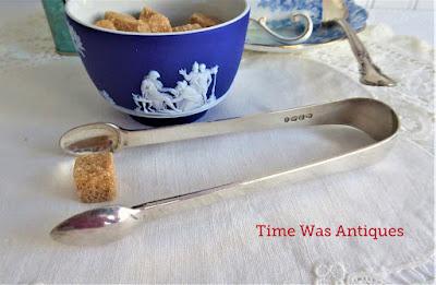 https://timewasantiques.net/products/hallmarked-english-georgian-sugar-tongs-sterling-silver-1828-antique-silver-1?_pos=1&_sid=03c9968c0&_ss=r