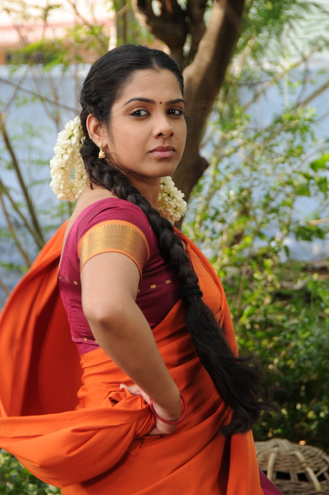 Actress Sandhya Latest Photos In Orange Saree
