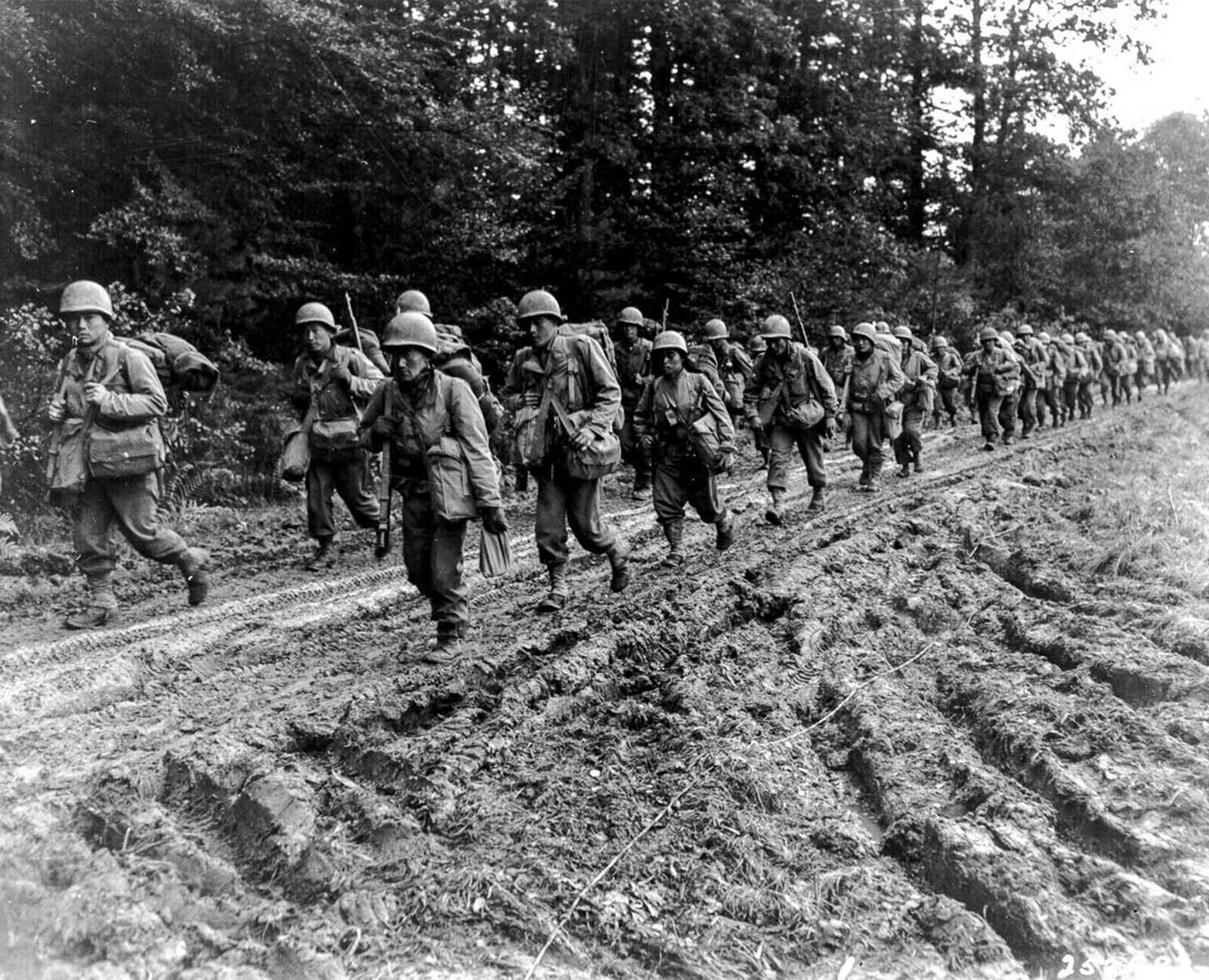 Members of the 442nd on the march in the Chambois Sector, France. 1944.