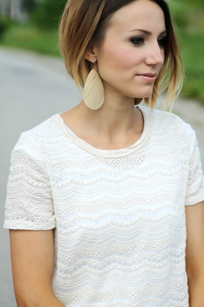 Gold leather earrings, cream lace tee