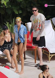 Kaia Gerber in tiny wet black bikini tongue kissing Pete Davidson in Miami Beach Pool Celebs.in Exclusive 056